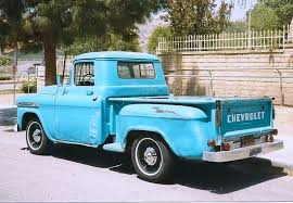 AN OLD PICKUP TRUCK